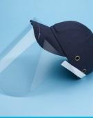 Baseball cap with protective shield